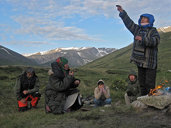 At a sacred radon spring below the mountain pass to the Ukok Plateau, Maya Erlenbaeva offers milk at a sunrise ceremony before heading out onto the plateau.