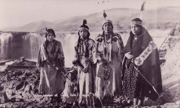 Celilo women standing before the falls. Photo courtesy of the Columbia Gorge Discovery Center.