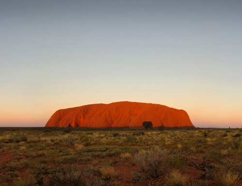 Uluru at dusk. Photo by Michael Nelson.  Parks Australia